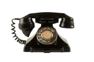 Old 1950s bakelite dial telephone isolated on white with clipping path